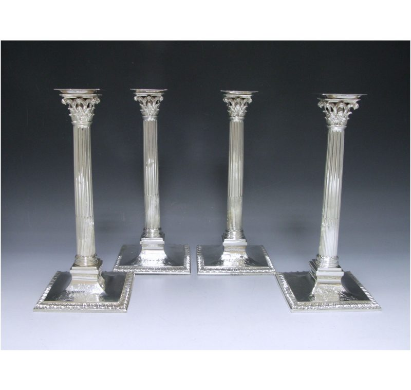 Set of Four George III Cast Silver Candlesticks